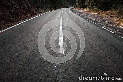 Empty dark rural asphalt highway perspective
