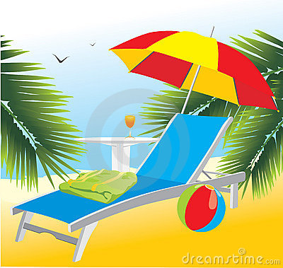 Empty deckchair under an umbrella