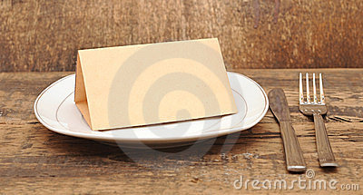 Empty dish with old paper