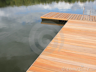 Empty dock in calm lake of Weiswampach