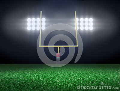 Empty football field with spotlights