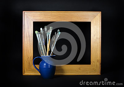 Empty Frame with Paint Brushes