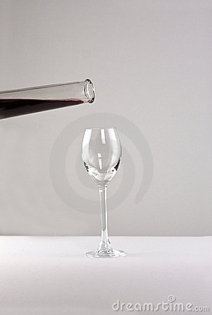 Empty glass with bottle of liquor