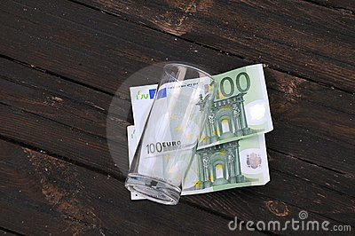 Empty Glass and Two One Hundred Euro Banknotes