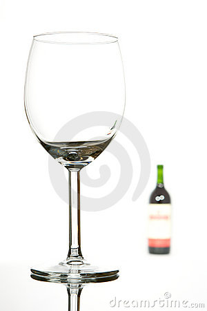 Empty glass and wine bottle