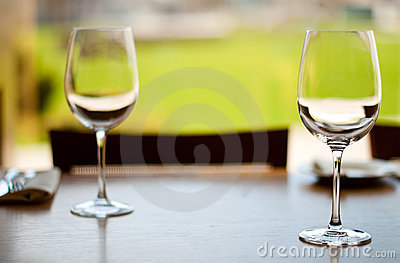 Empty goblets on table