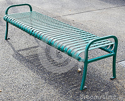 Empty green metal bench
