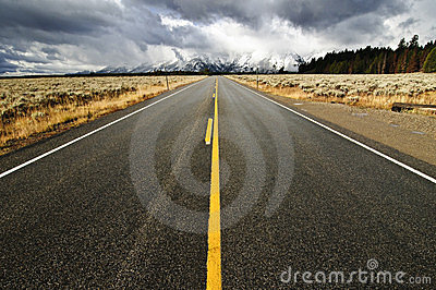 An empty highway in Teton National Park