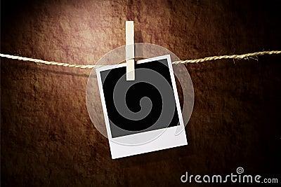 Empty instant photo on grunge background