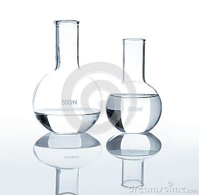 Empty laboratory flasks with a clear liquid
