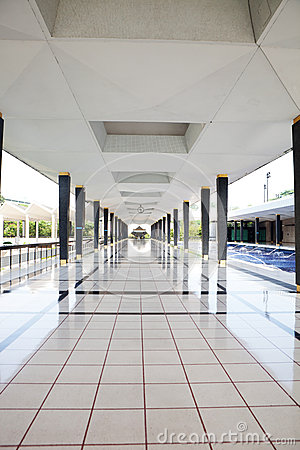 Empty long corridor in the modern building.