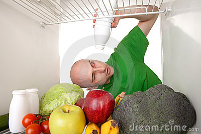 Empty milk bottle in fridge