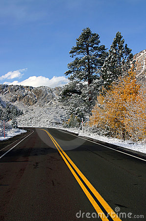 Empty mountain road with snow