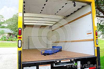Empty moving truck with dolly in back