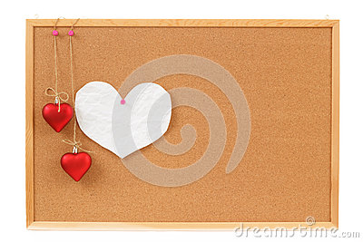 Empty note for heart valentine message on cork board