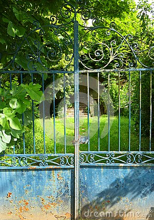 Empty old house, locked gate