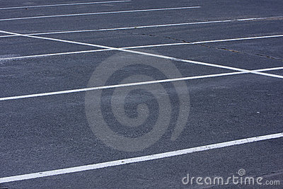 Empty parking lot with white lines