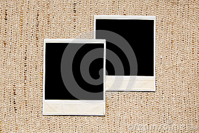 Empty photo frames on linen texture
