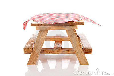 Empty picnic table with tablecloth