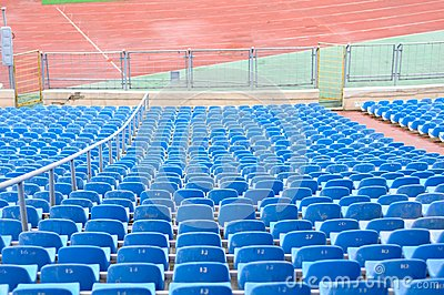 Empty Plastic Chairs at the Stadium