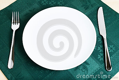 Empty plate, fork and knife