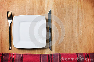 Empty plate with fork and knife, table arrangement