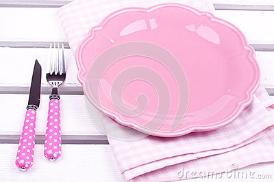 Empty plate , knife and fork