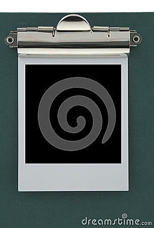Empty polaroid stuck to a clipboard