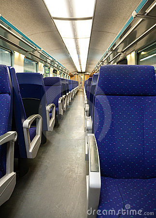 Empty railway carriage with blue seats