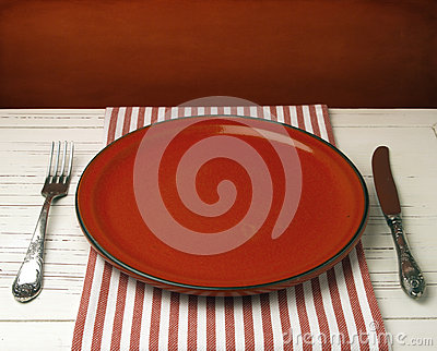 Empty red ceramic plate