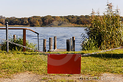Empty Red Sign before Lake Copyspace