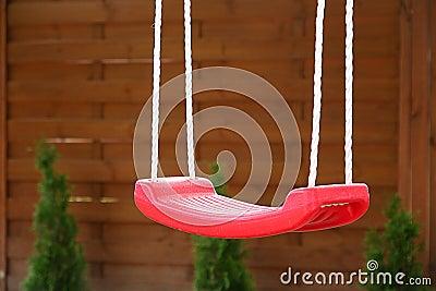 Empty red swing