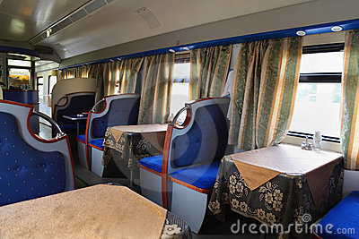 Empty restaurant with blue seats in train