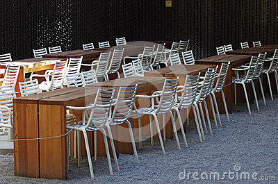 Empty restaurant tables and chairs