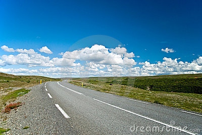 Empty road with a beautiful blue sky in horizon