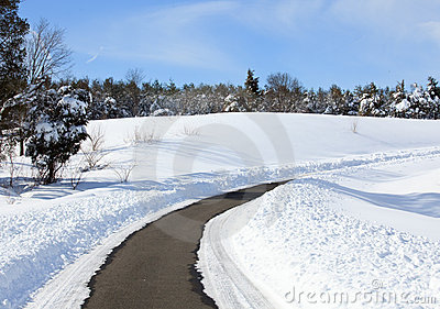 Empty road cleared of snow