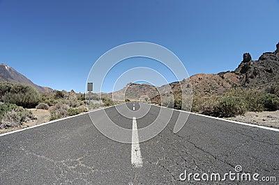 Empty road in the desert to infinity