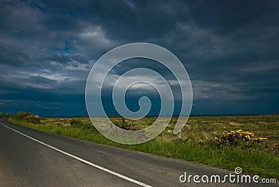 Empty road under blue sky, Ireland