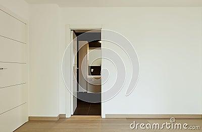 Empty room with the bathroom door open