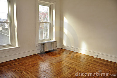Empty room with hardwood floors