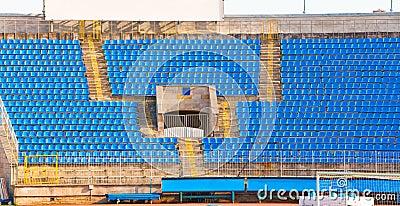 Empty rows of seats at football stadium
