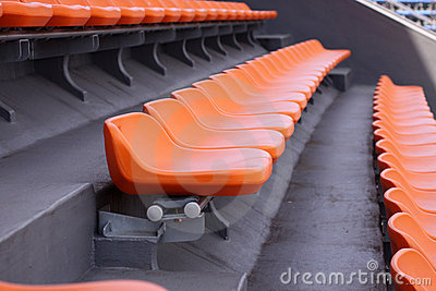Empty seat rows in a track and field stadium