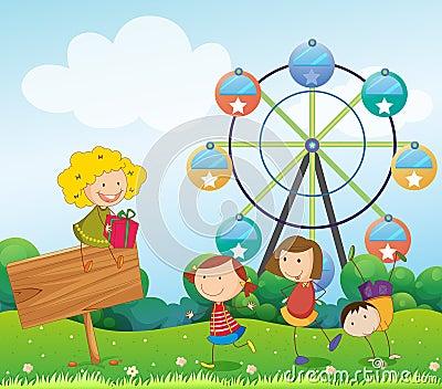 An empty signboard with kids near a ferris wheel