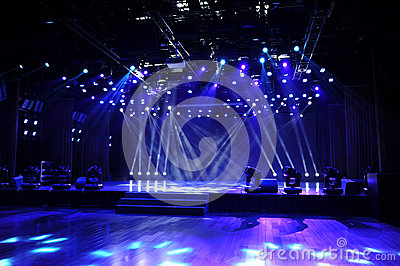 Empty stage in blue light beam