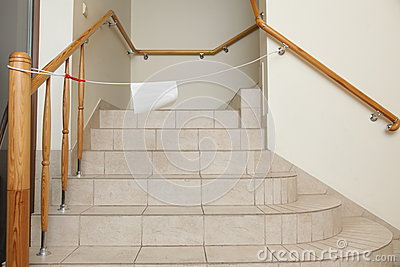 Empty stairway with tiled floor. No entry sign.