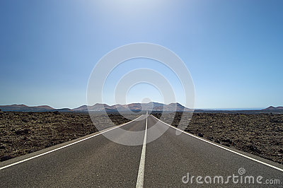 Empty and straight road through the lava fields