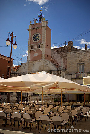 Empty street cafe near belltower in zadar, croatia