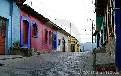An empty street with typical Mexican houses