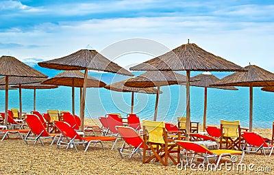 Empty sun beds with umbrellas on the beach