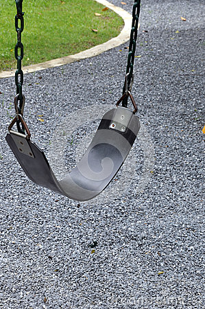 Free Empty Swing In A Pebble Background Stock Photos - 26338183